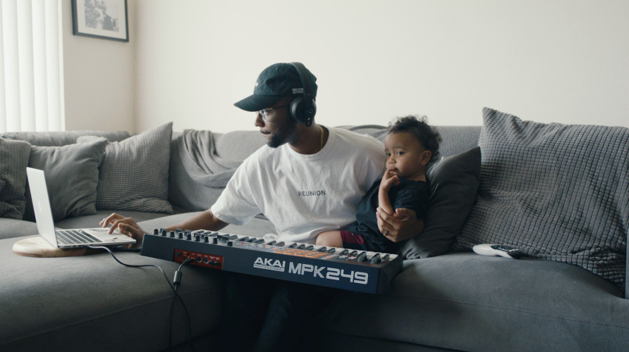 A photo of Sango and his son on the couch, making music on a piano