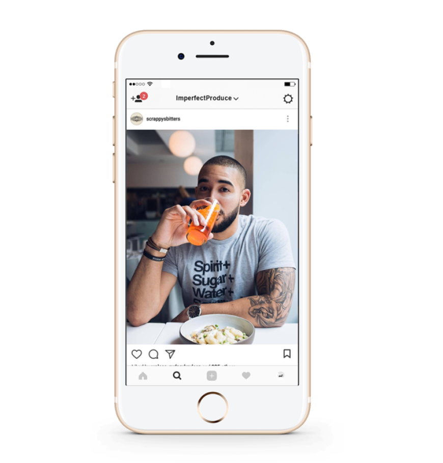 Screenshot of Scrappy's Bitters Instagram post showing a man drinking an orange cocktail