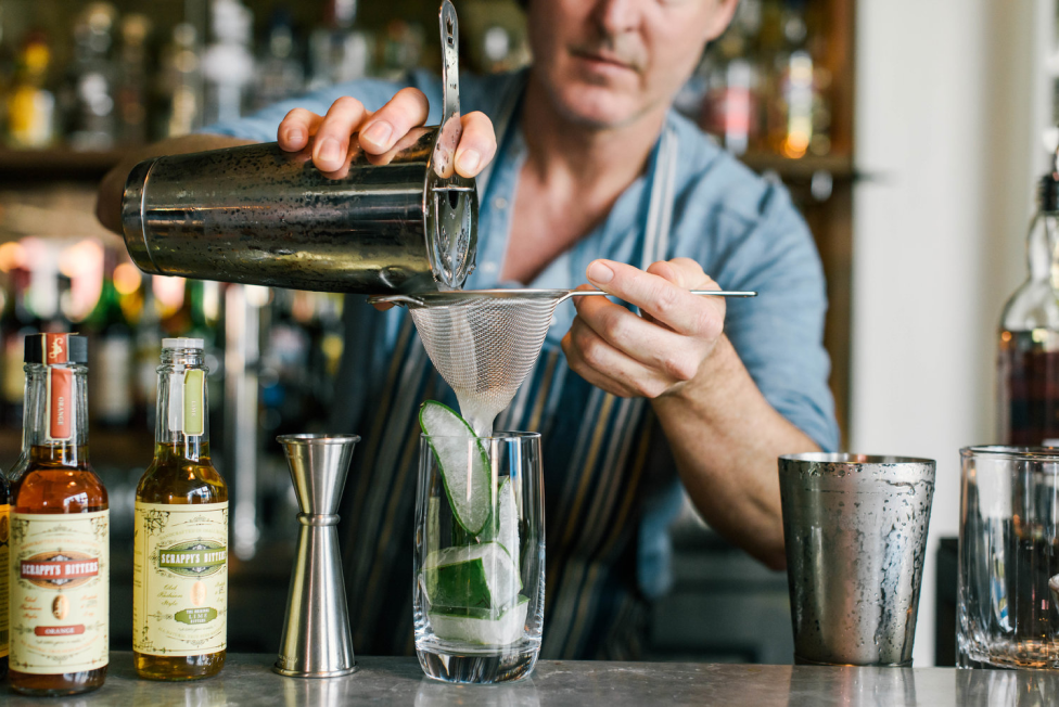 Man pouring drinks at a bar