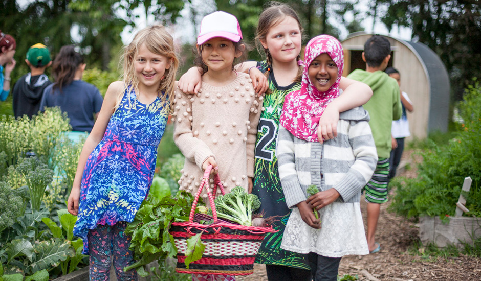 Image of 4 children taking part in the Garden to Table school programme