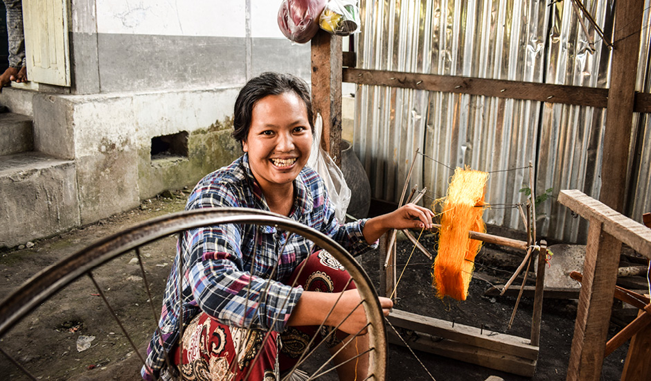 Image of a lady in Burma who is recipient of microfinance loan through ADC