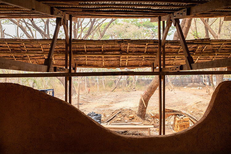 Construction of adobe mud brick classroom.jpeg