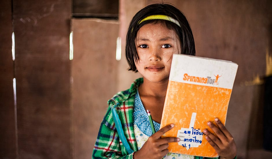Image of child on the Thai and Burma border, with donated educational supplies