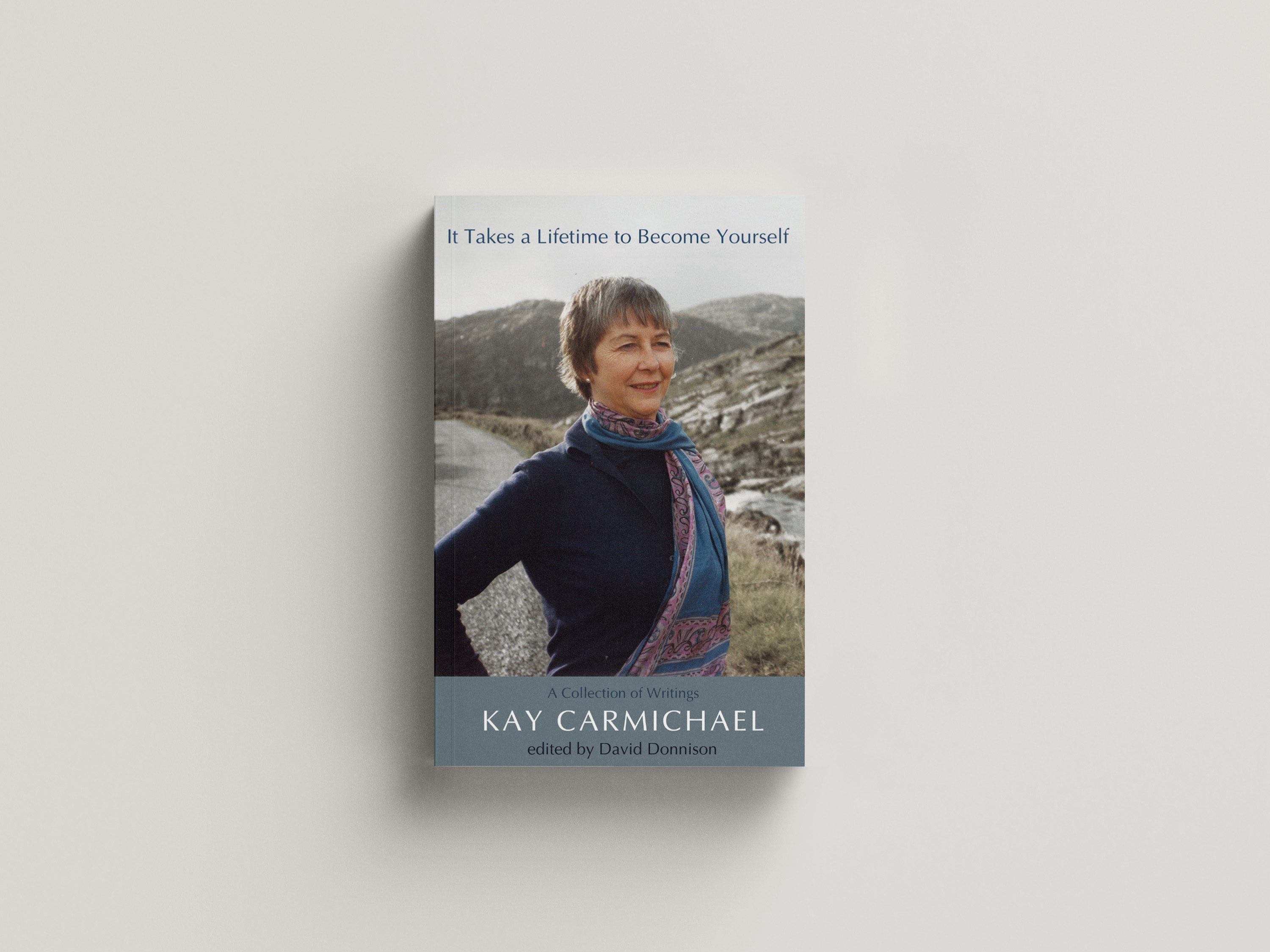 A portrait of Kay Carmicheal witha backdrop of hills