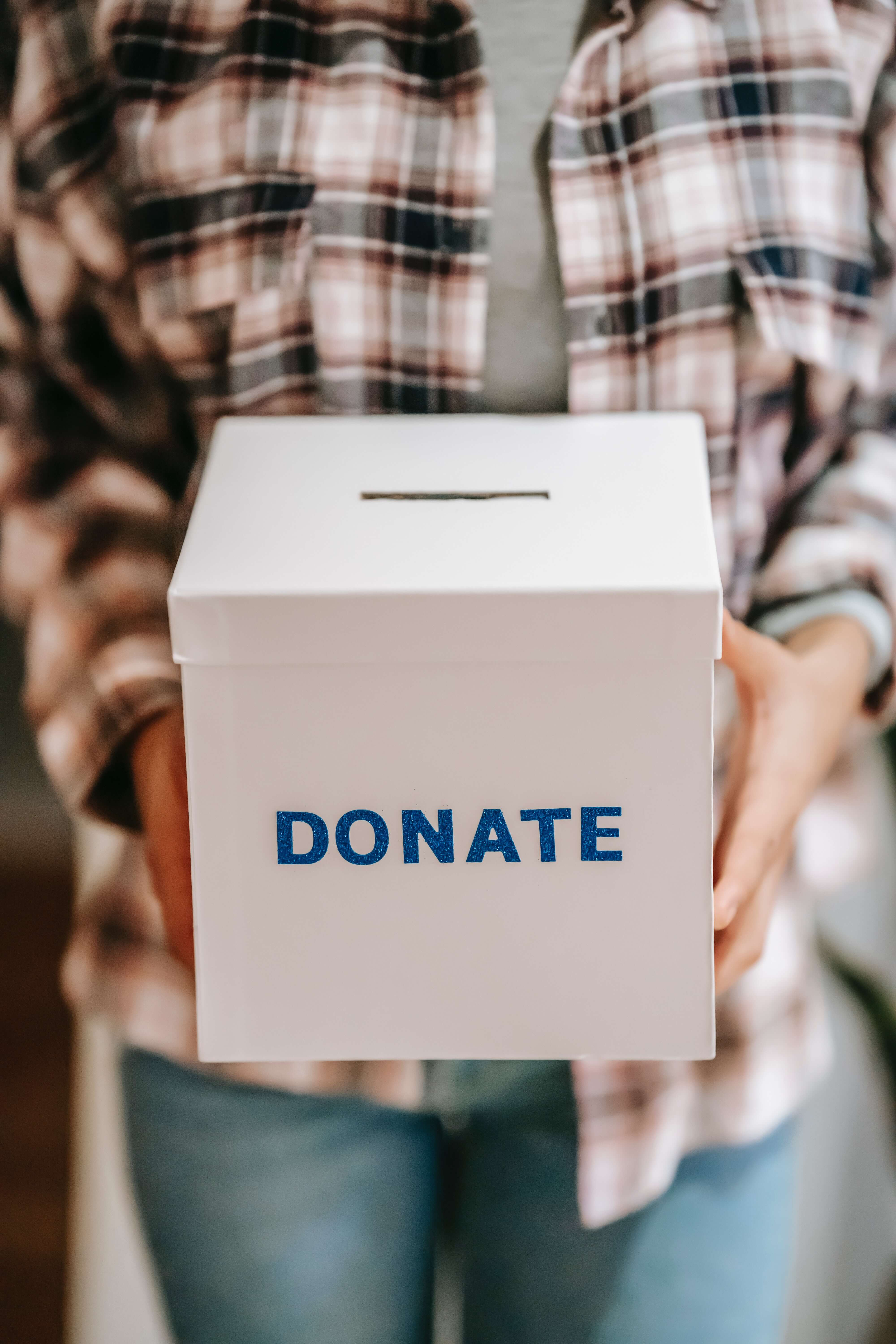 person holding a donation box
