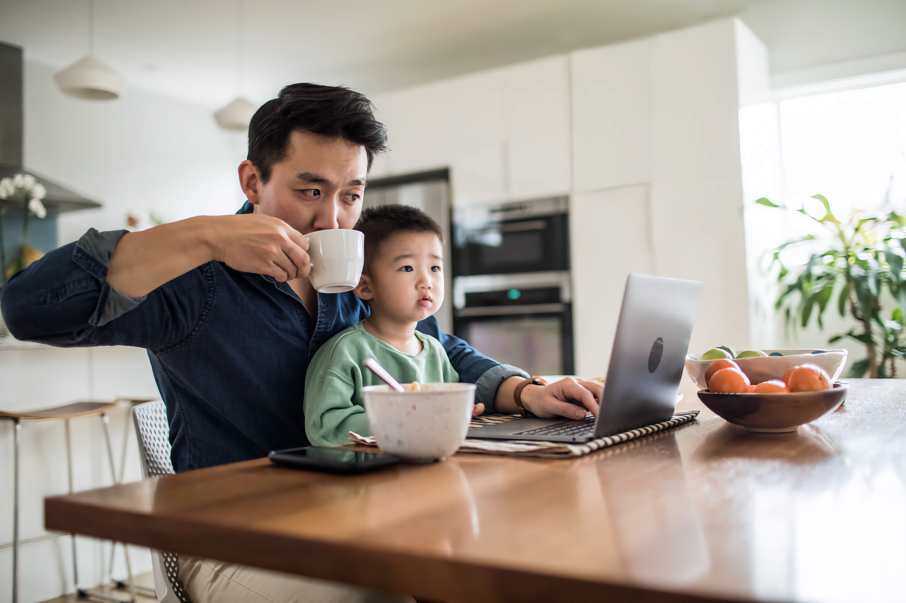 Asian man working with his child
