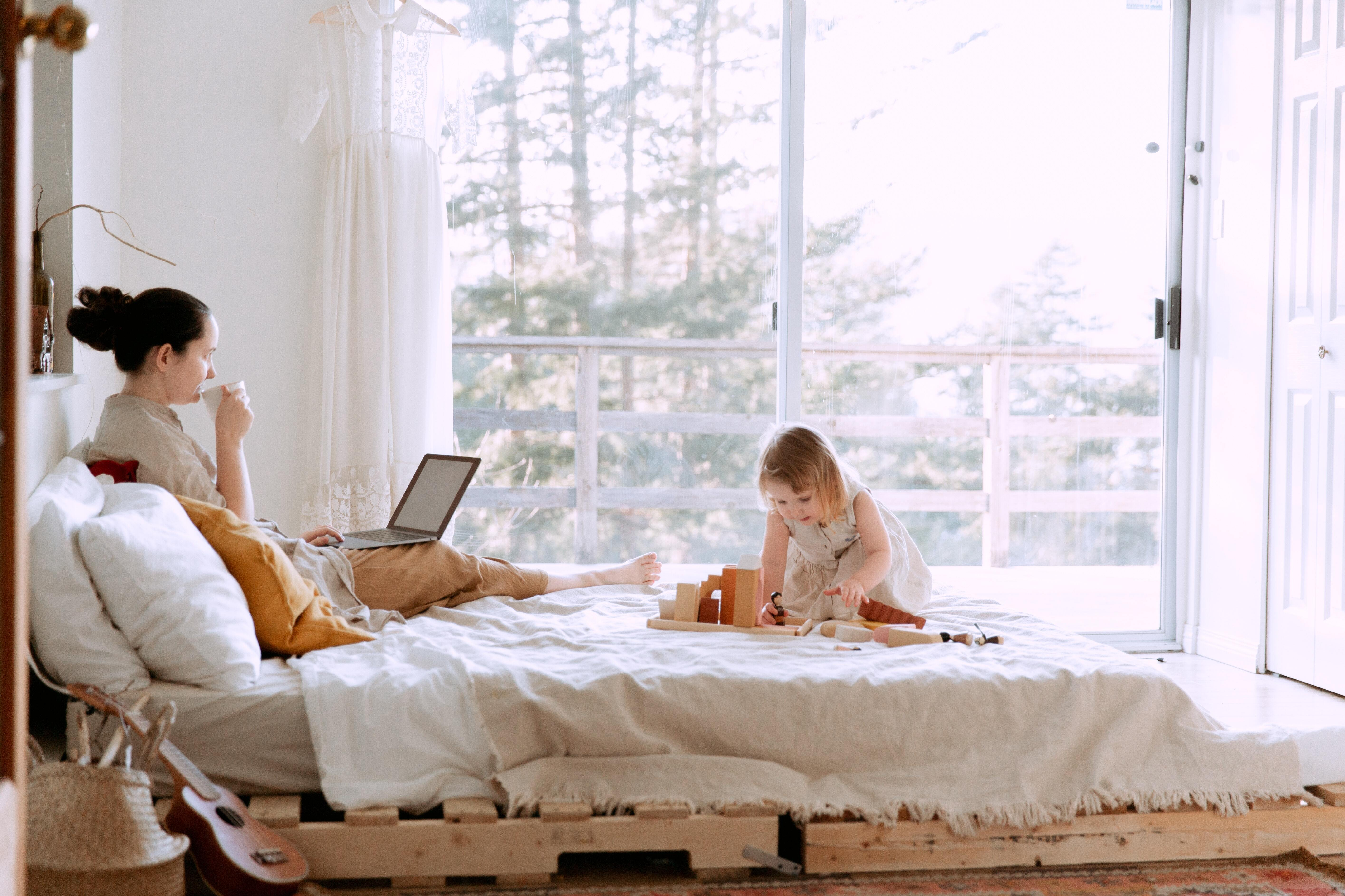 working woman on bed with child