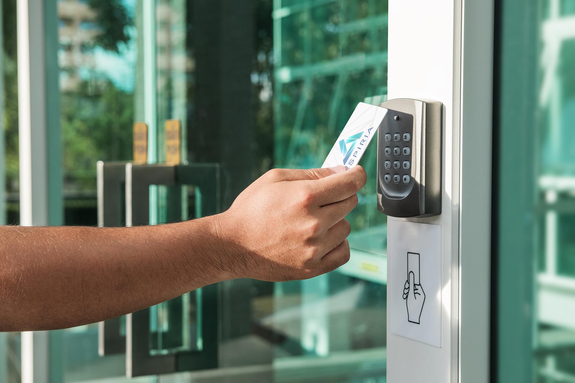 A man swipes his access card to enter an Aspiria building.