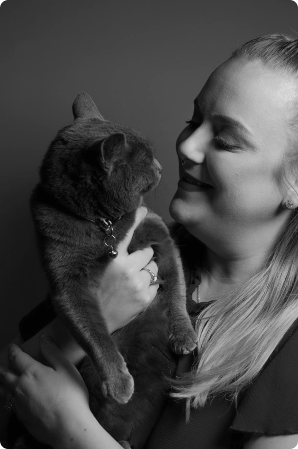 A grayscale picture of my wife holding our cat, Cloe