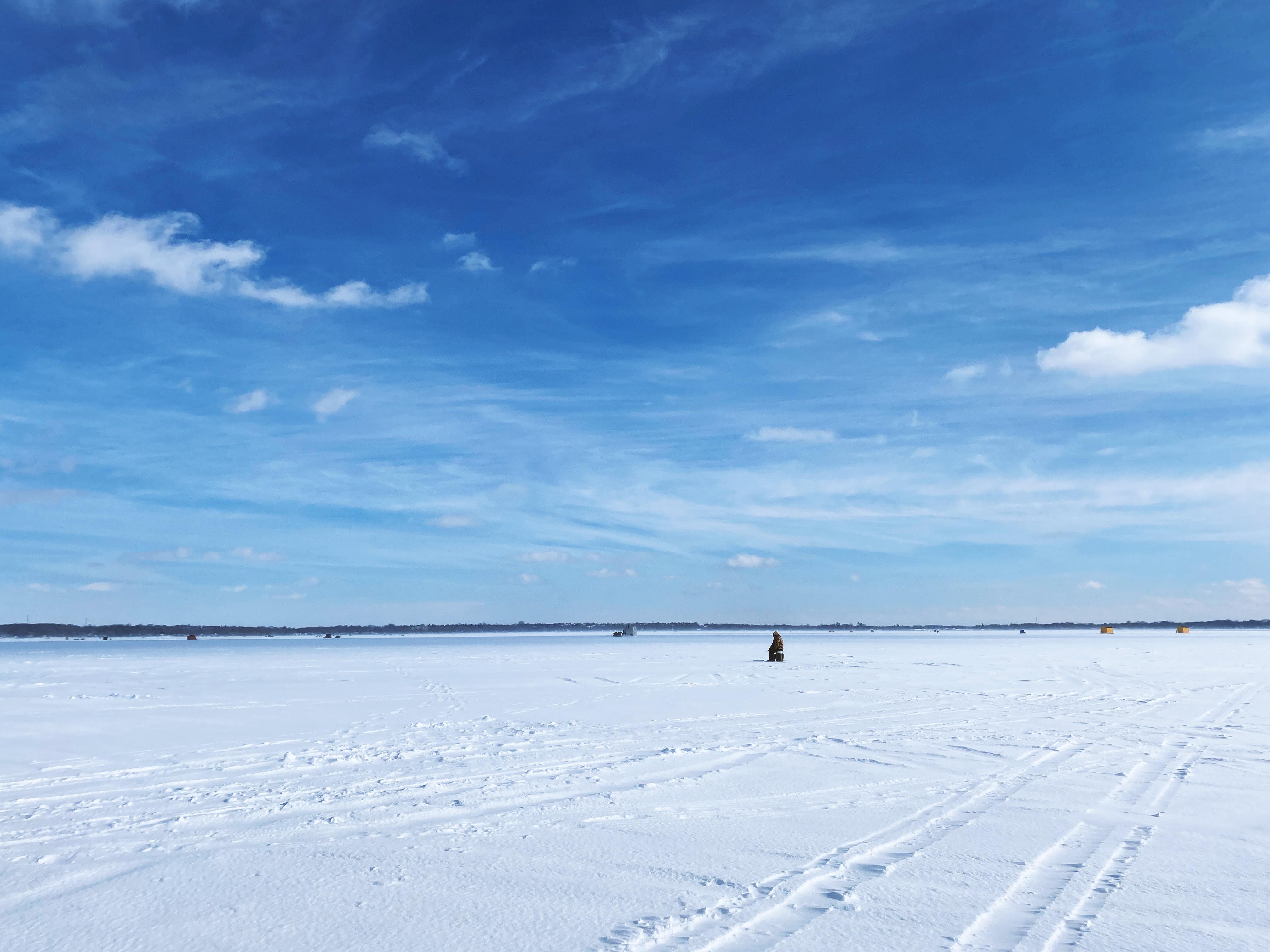 Photo - a man ice  fishing on Lake Simcoe
