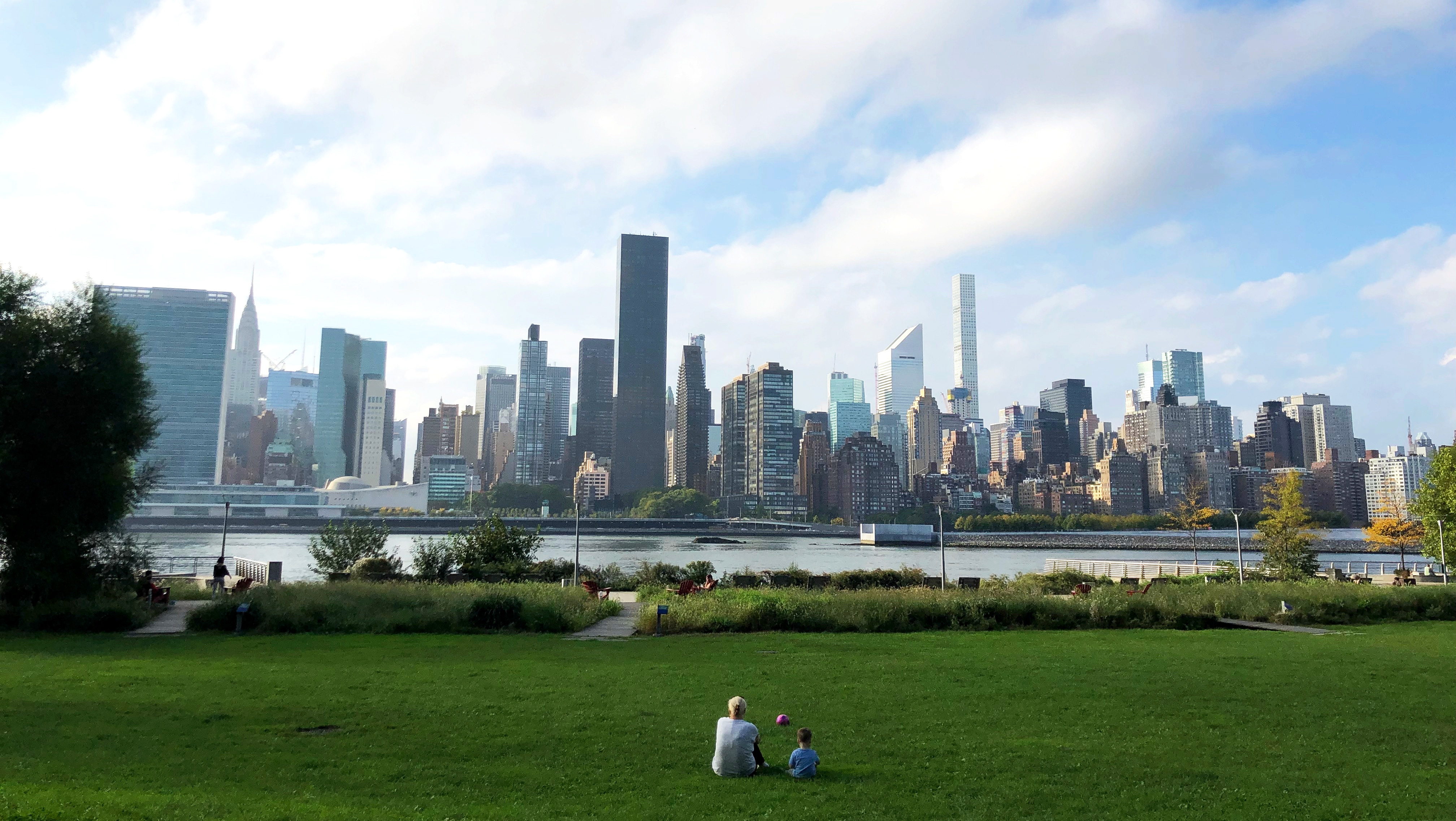 Photo - a mom and her child sitting across to Manhattan