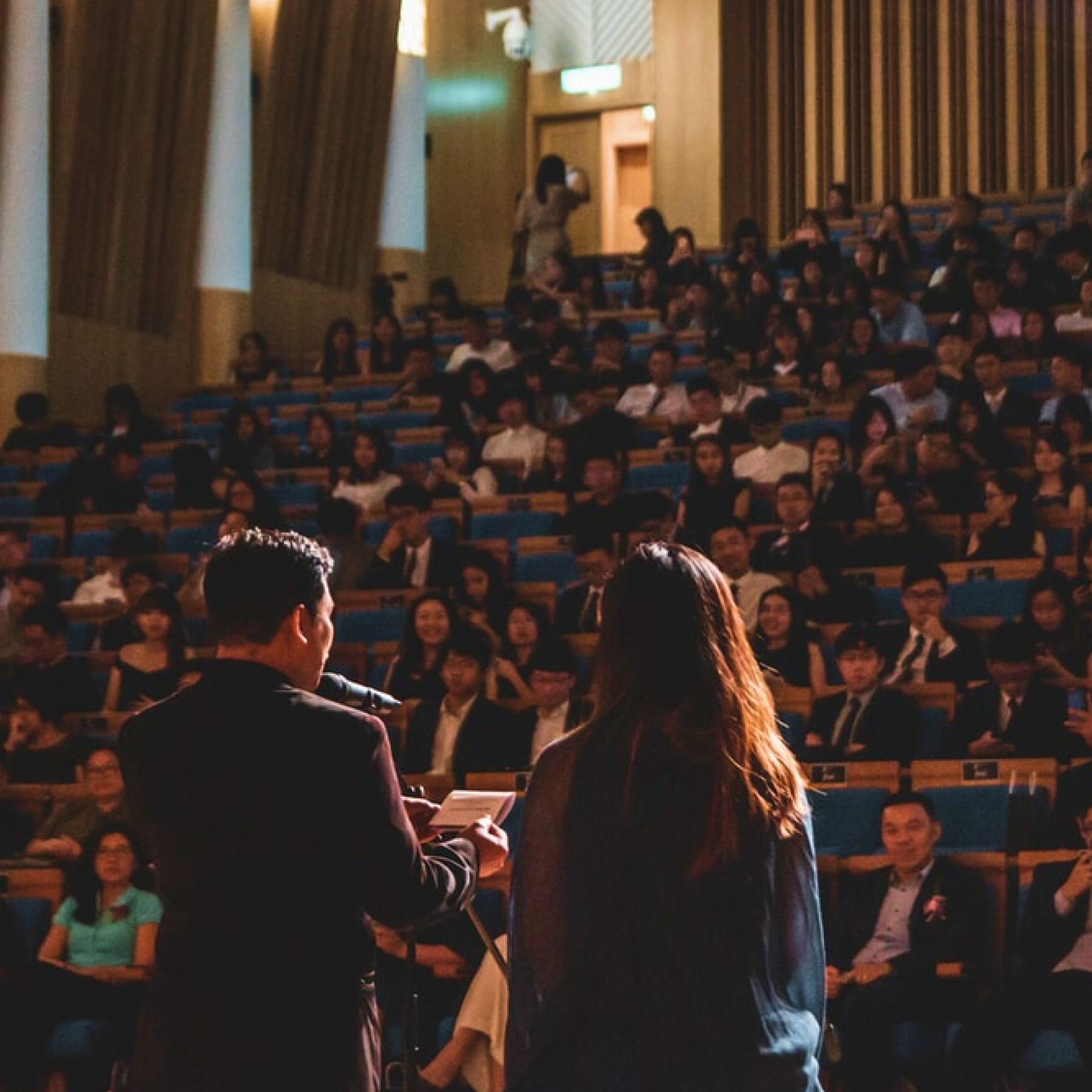 An educator speaking at a lecture.