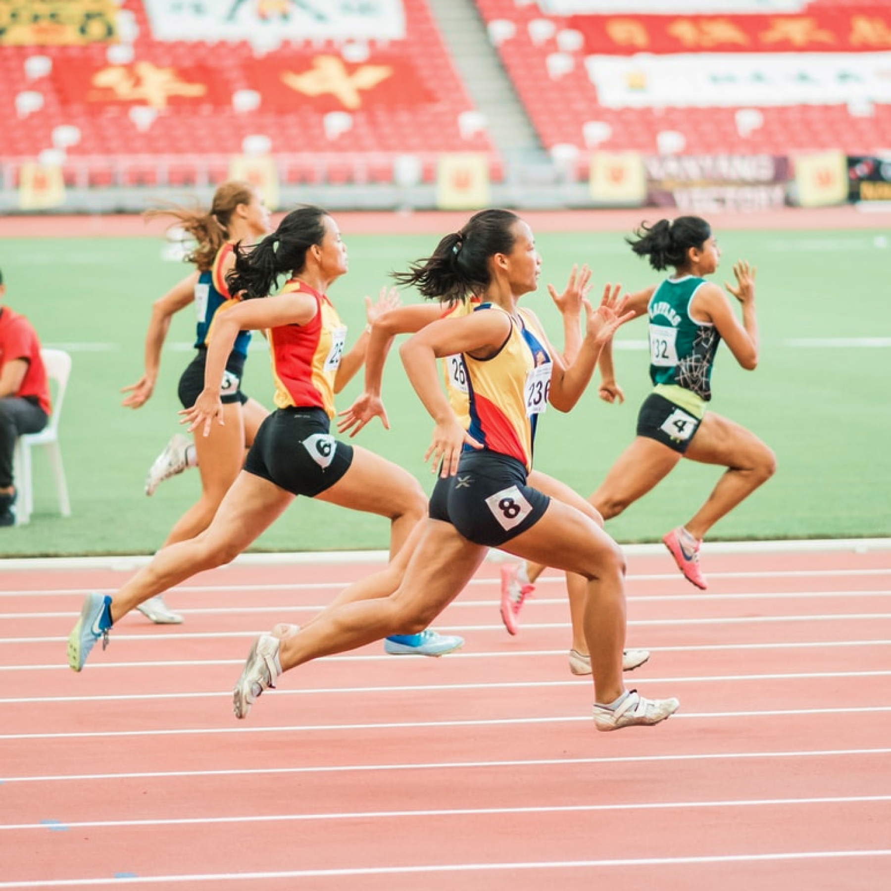 Track athletes running a race.