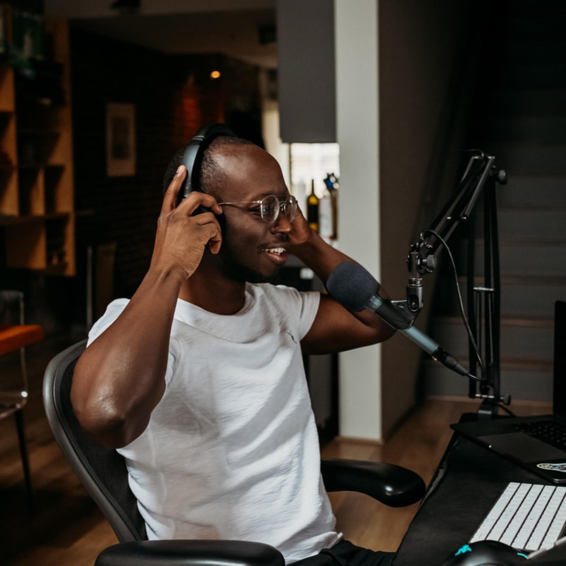 A creator recording a podcast.
