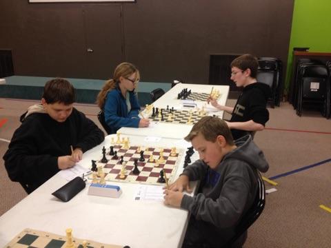 kids playing chess tournament in progress