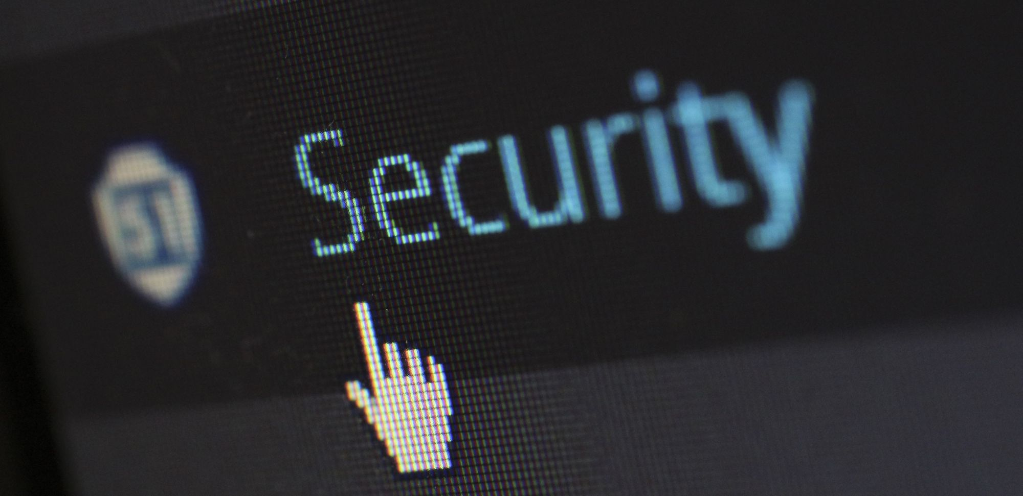 pointing to the word security on a computer screen