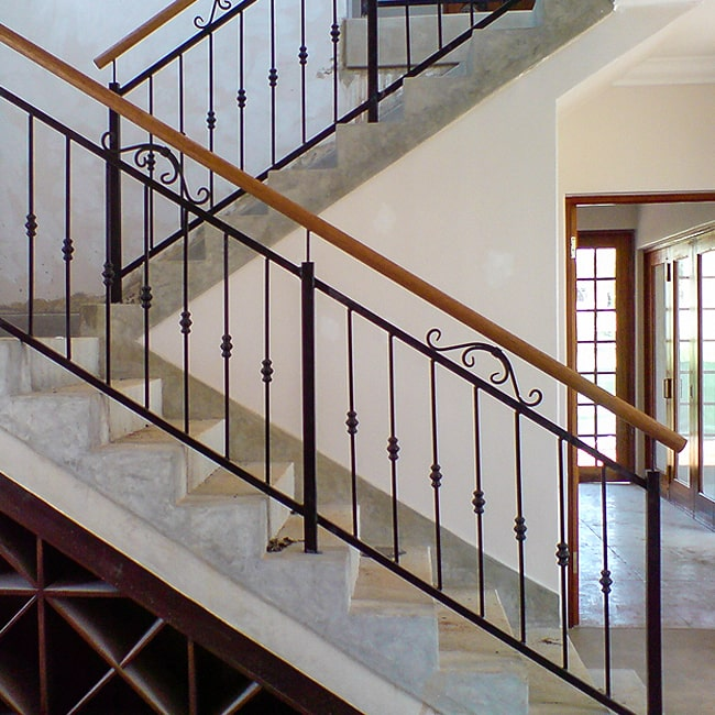 Mild steel and wood staircase banisters
