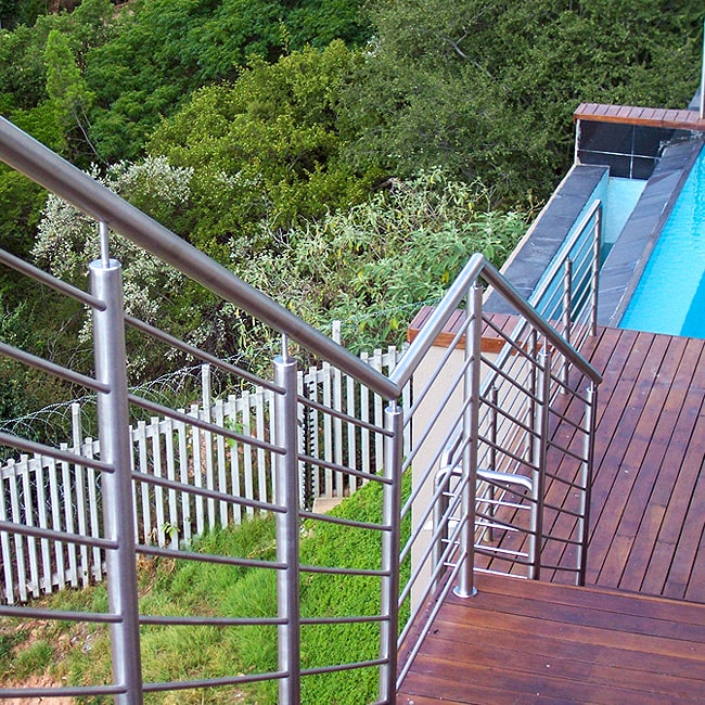 Solid steel safety rails for stairs