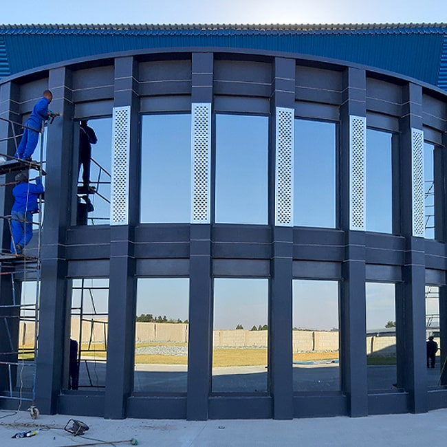 Perforated stainless steel cladding installations