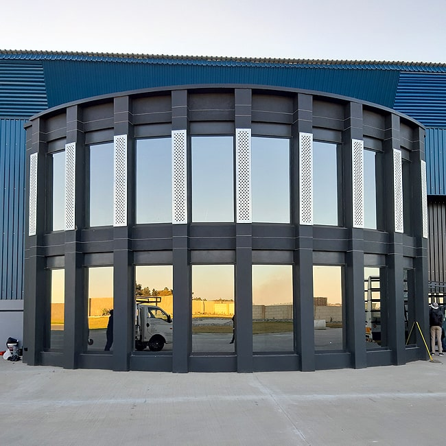 Perforated steel cladding installers