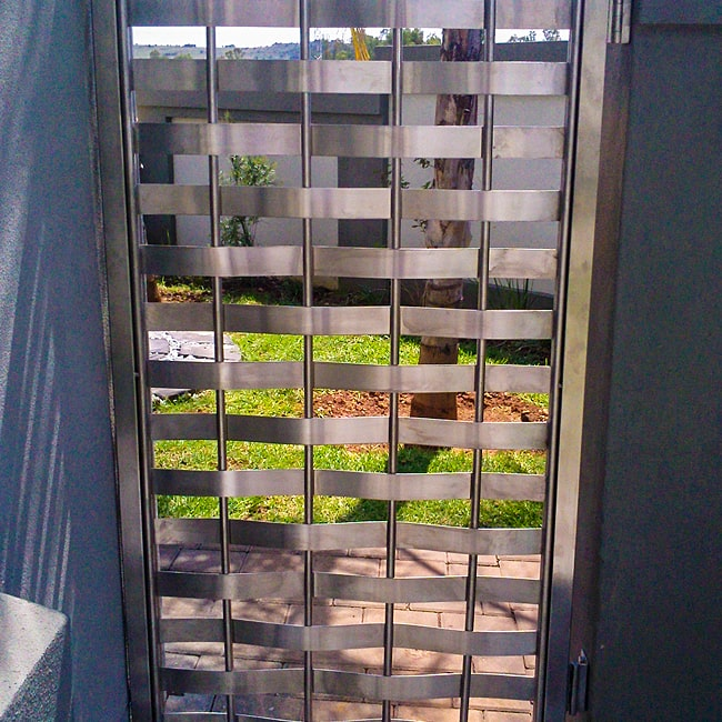 Woven stainless steel gate