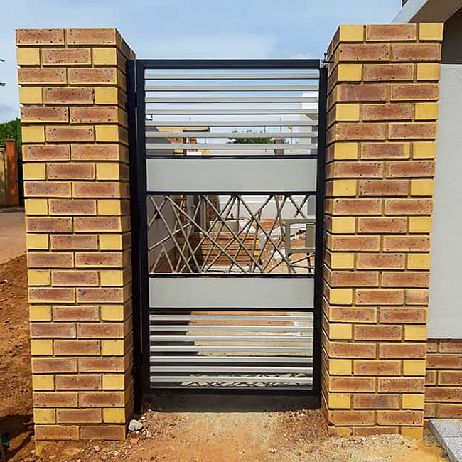Custom made steel security gate with wrought iron detail