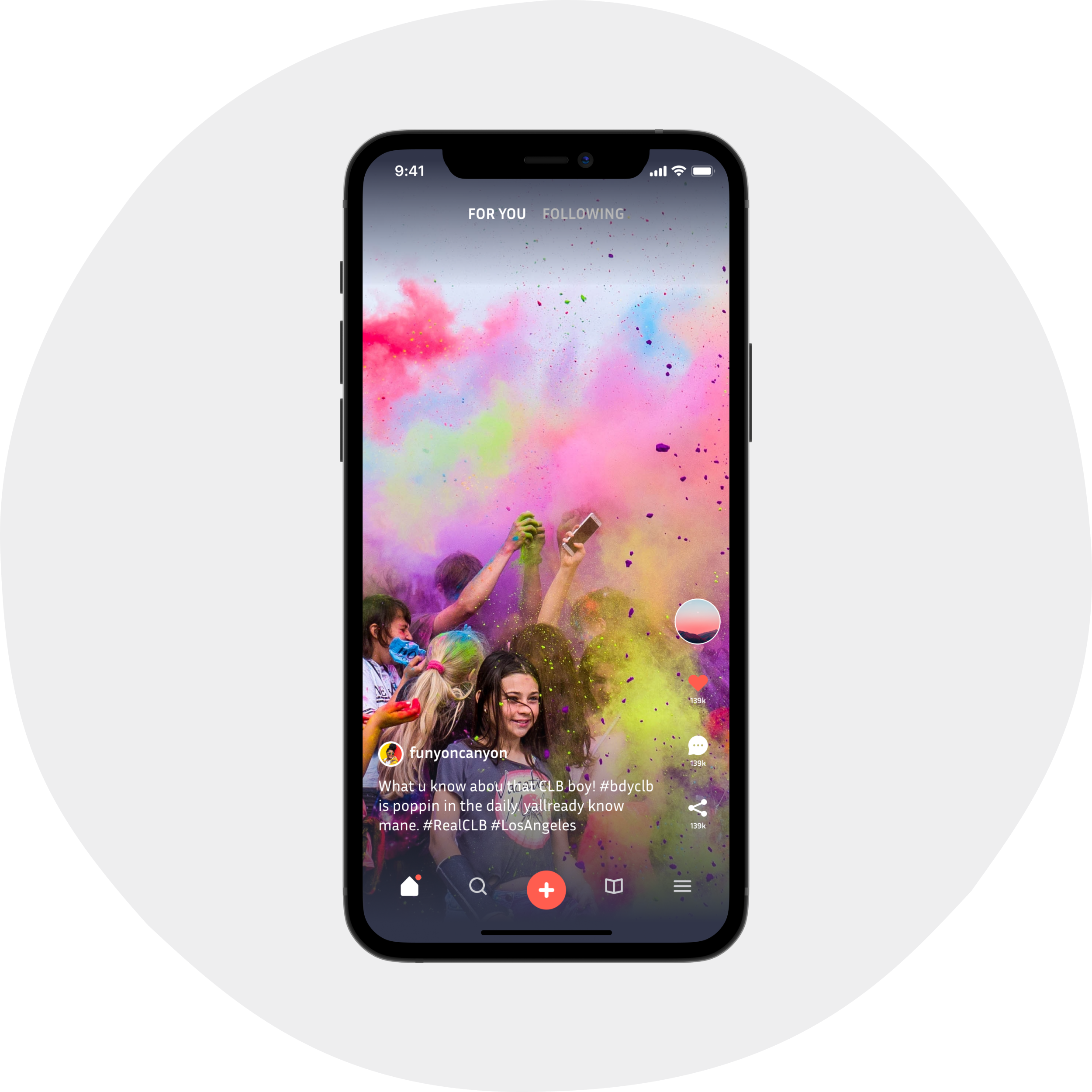 Picture of someones hand holding a smartphone. In said hand they have an app open on a video. Some huge colorful party...the video's focused on someone who is not on their phone. Nice one.