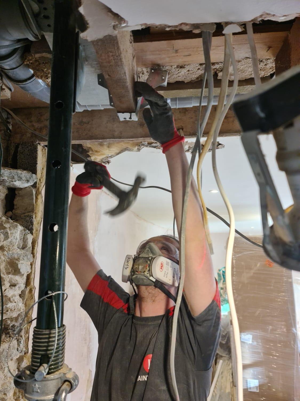 JR Maintenance worker in kitchen