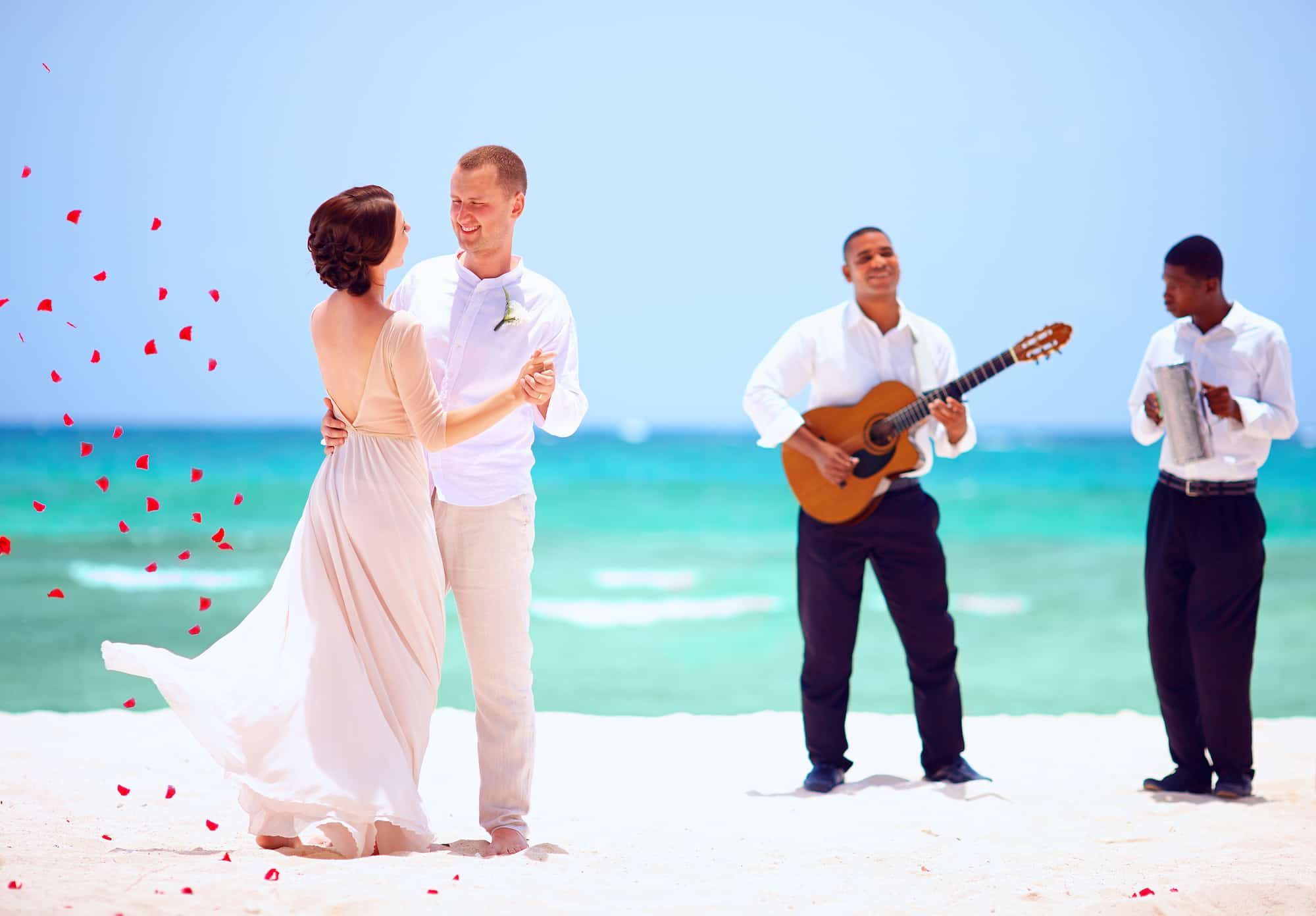Couple at a destination wedding at the beach
