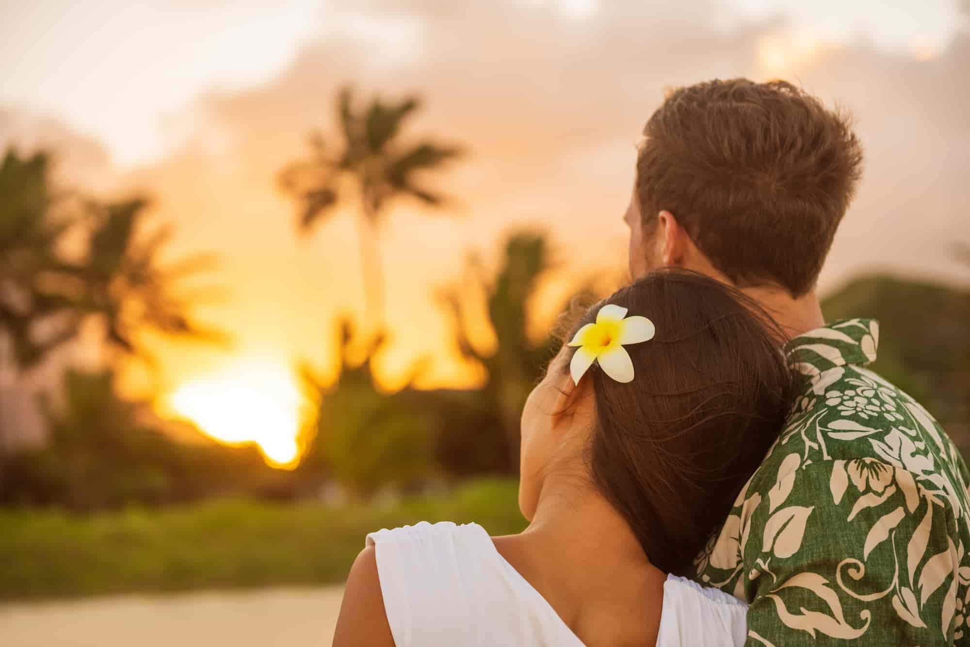 married couple at hawaii sunset