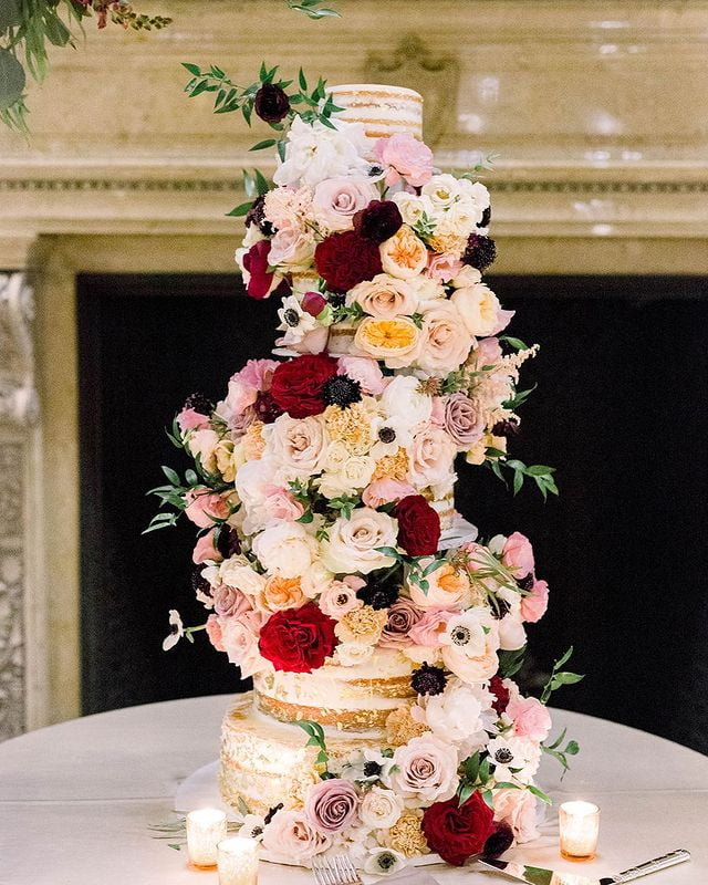 fresh flowers covered tiered naked wedding cake
