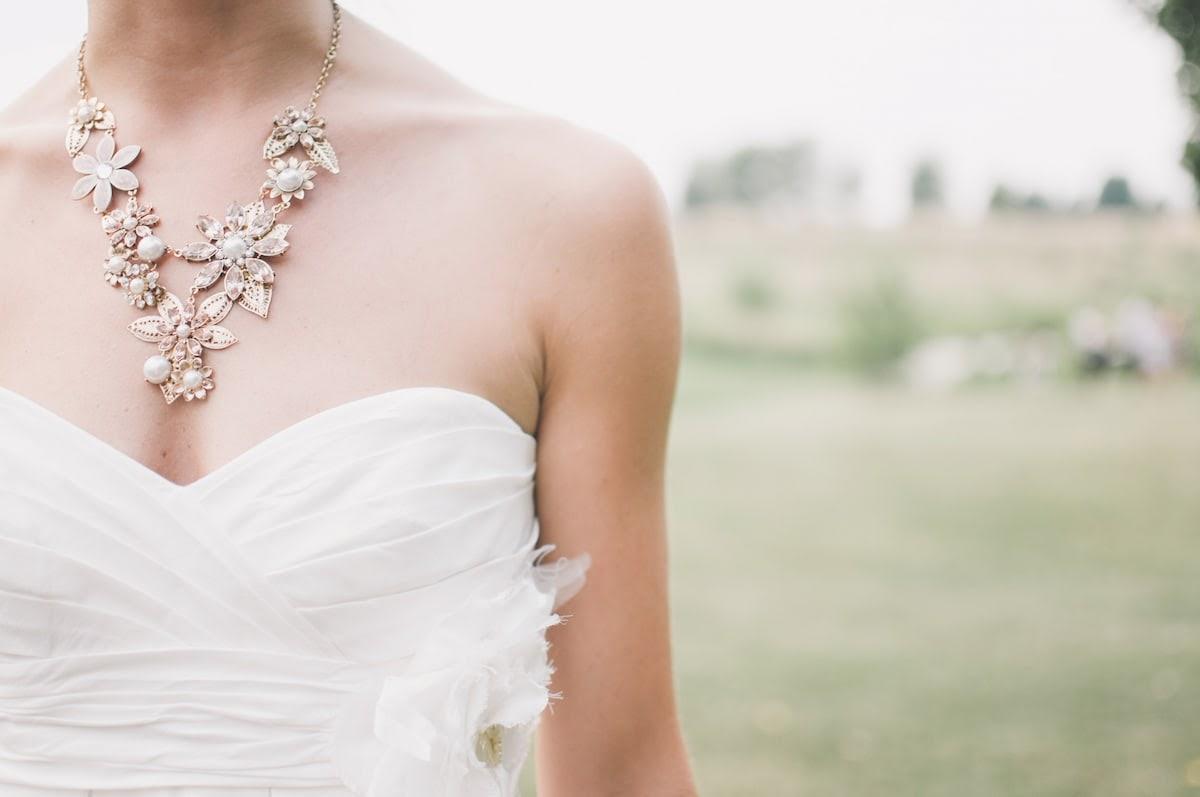 Bride wears statement jewelry from a jewelry rental service on her wedding day