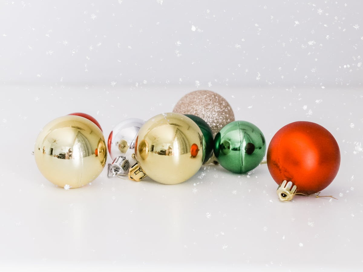 Christmas wedding ideas for color palettes include red, gold, green, and white or silver