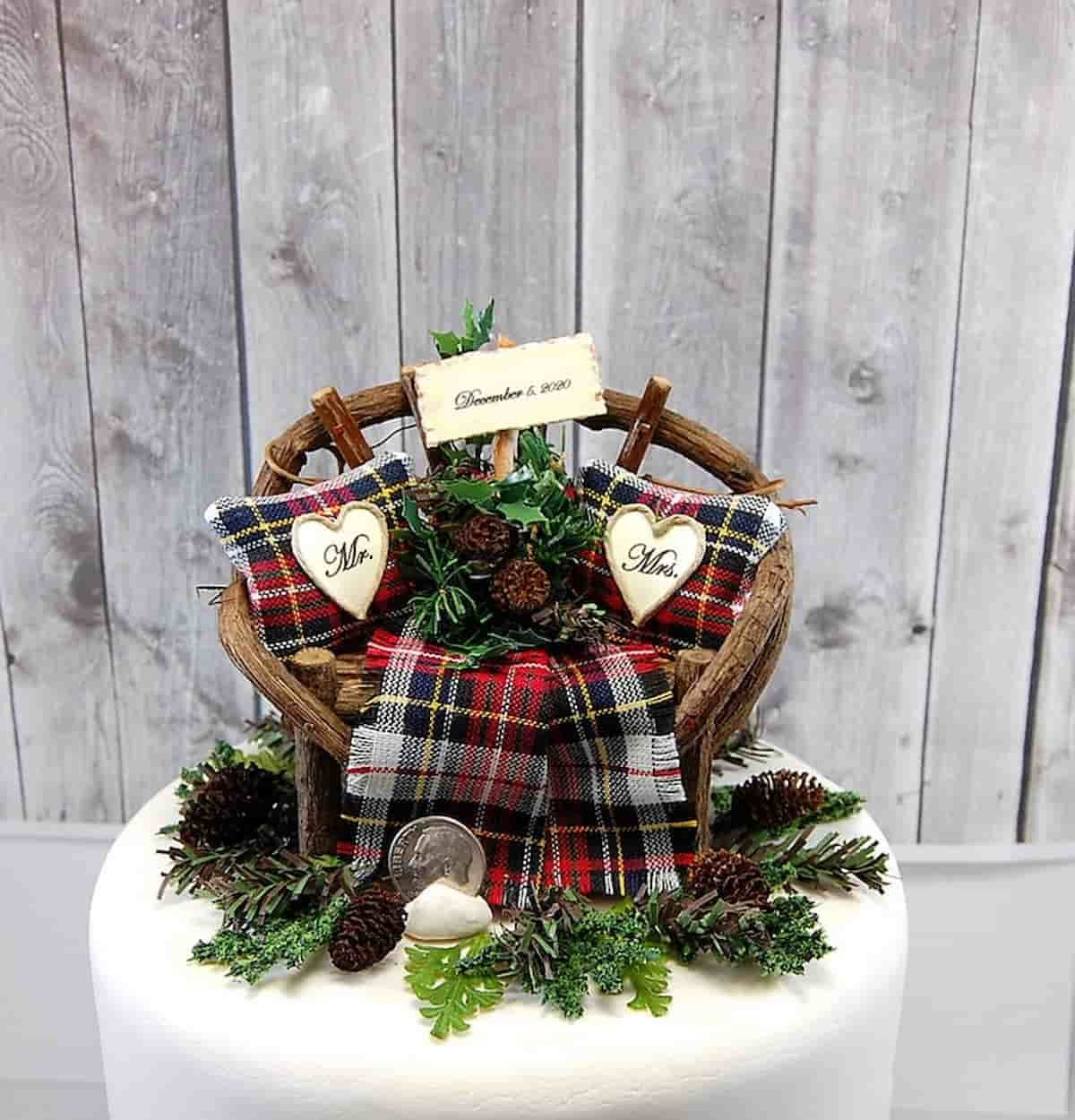 A winter themed wedding cake topper is perfect for a rustic Christmas wedding