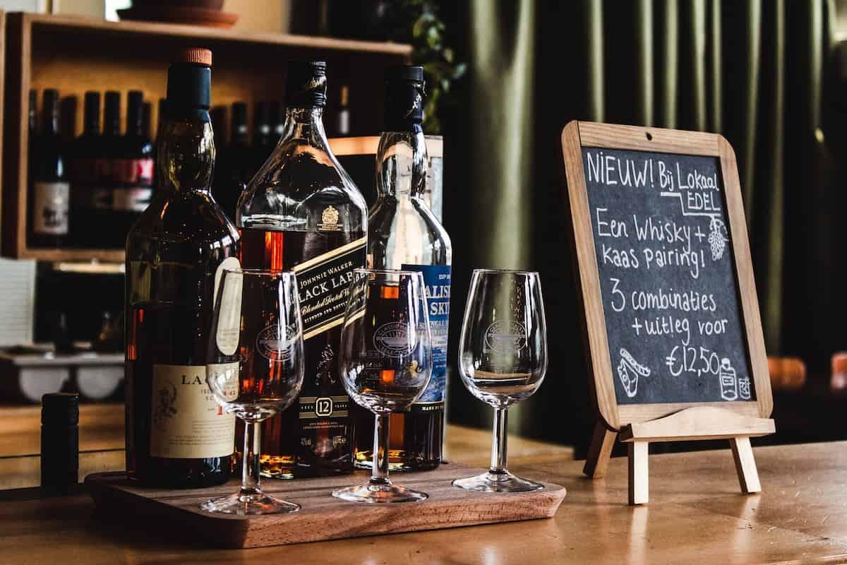 A bourbon bar is set up during a Christmas wedding reception