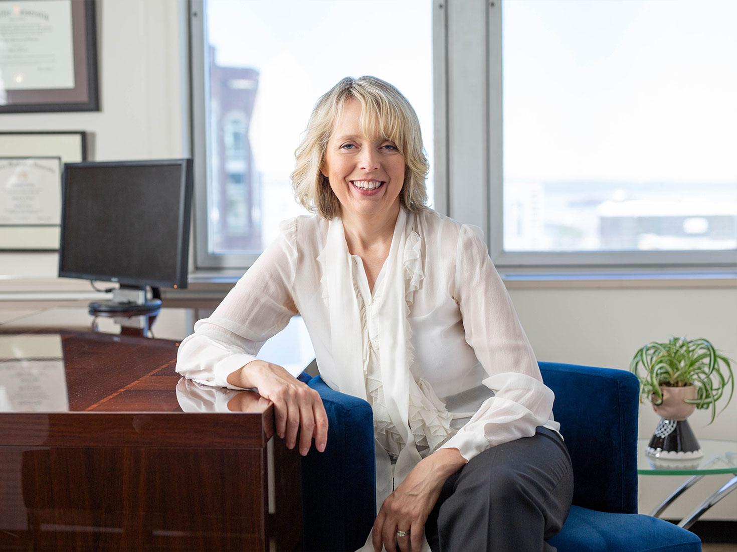 Michelle O'Loane sitting in her office.