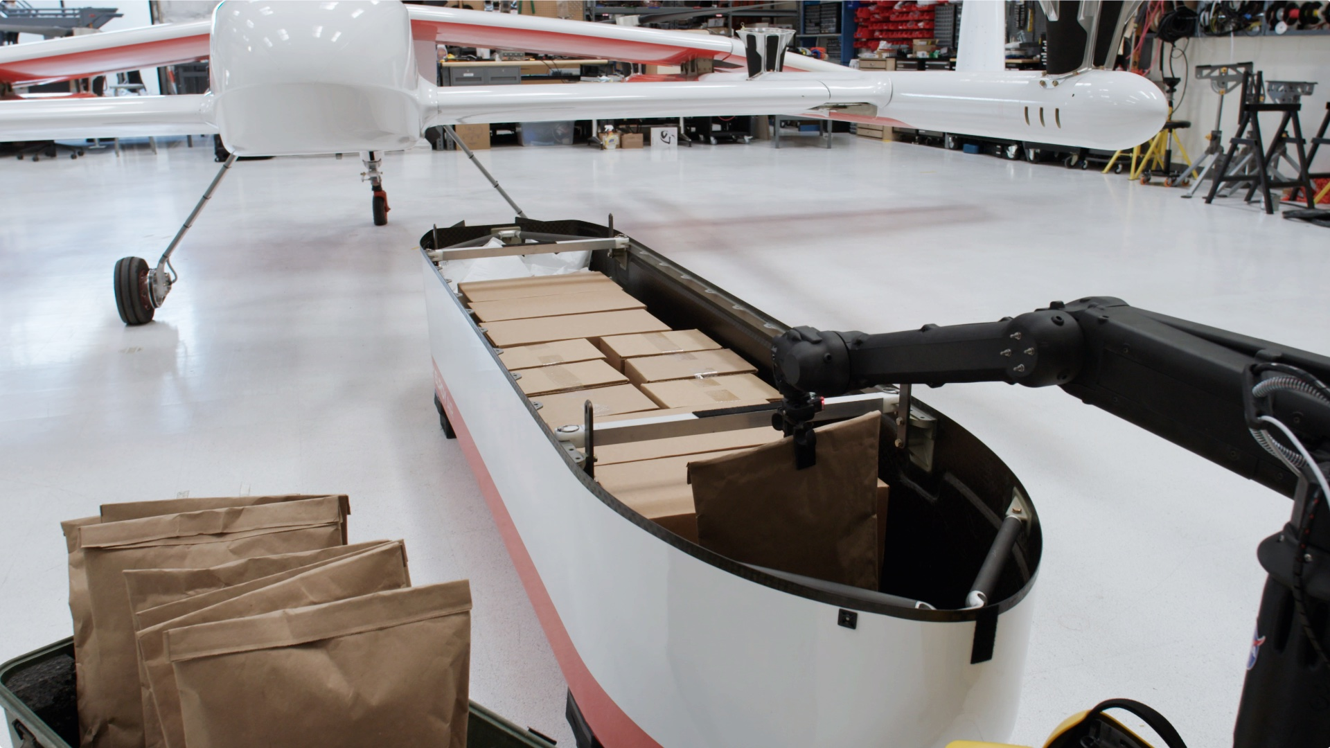 Picture of the Chaparral cargo pod being loaded by autonomous robots pre-flight.