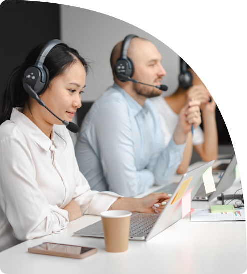 Woman and guy using extra large headsets while on laptops