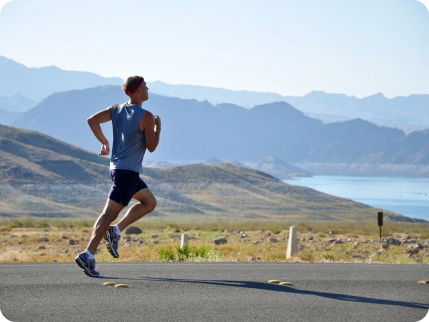 Man jogging with mountains behind him
