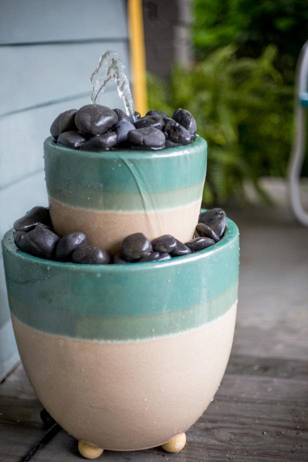 Pots with rocks turned into a water feature