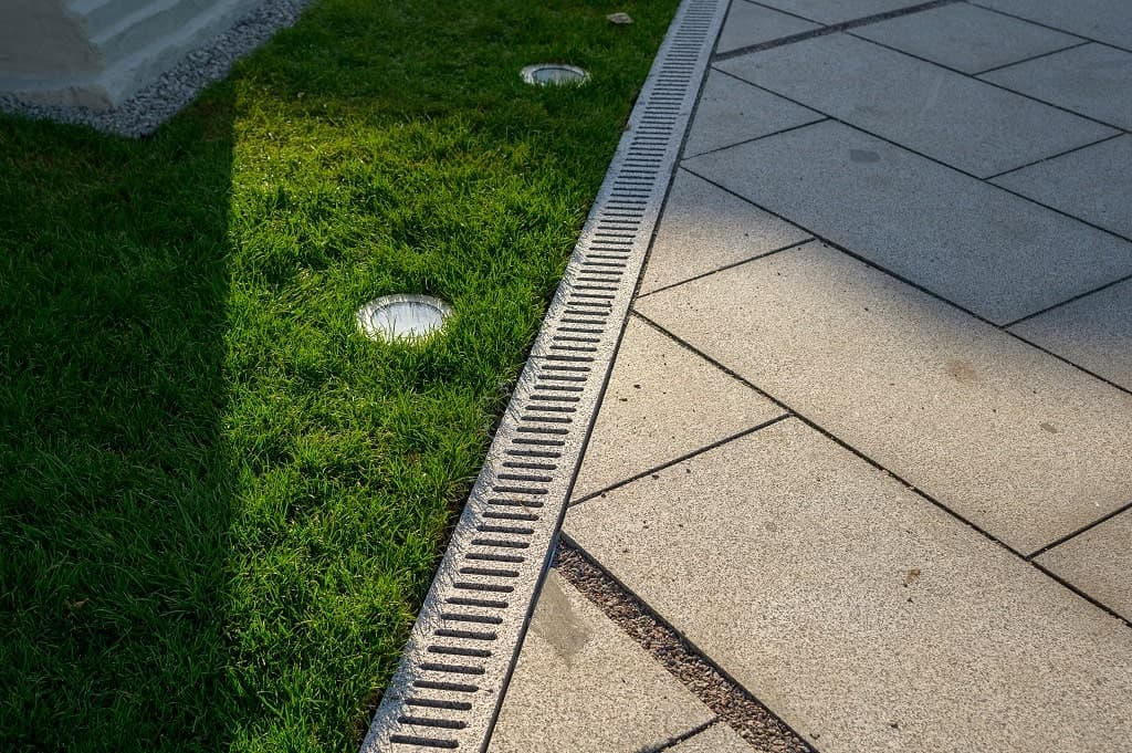 Who To Call For Drainage Problems On Your Commercial Lawn In Wisconsin?