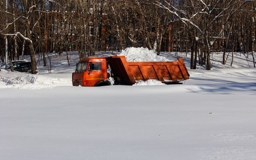 A dump truck transports the removed snow.