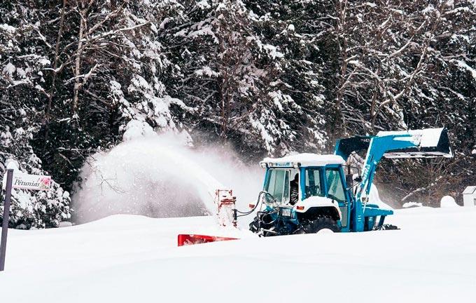 Snow plow tractor in Wisconsin
