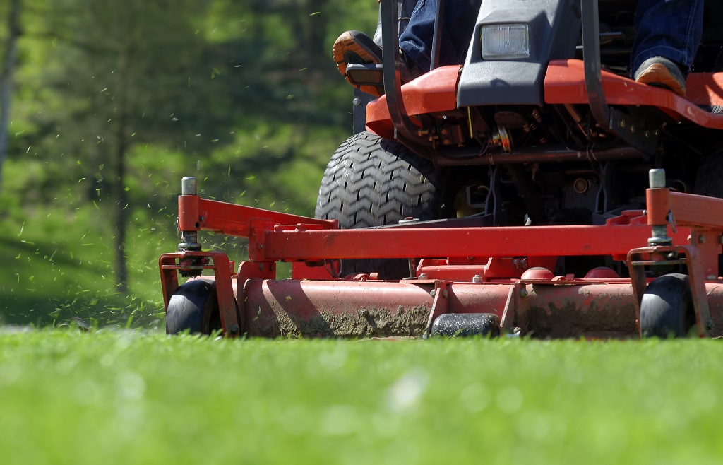 Lawn Mowing for Green Grass in Spring