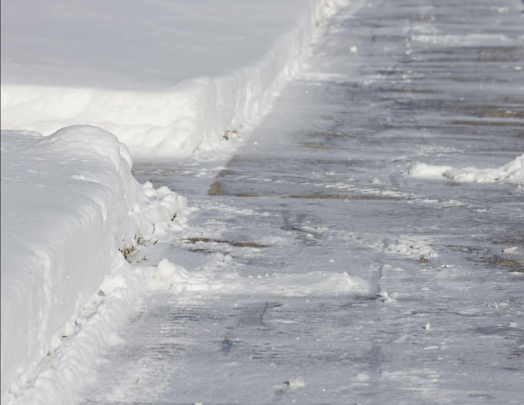 Salting Sidewalk in Winter
