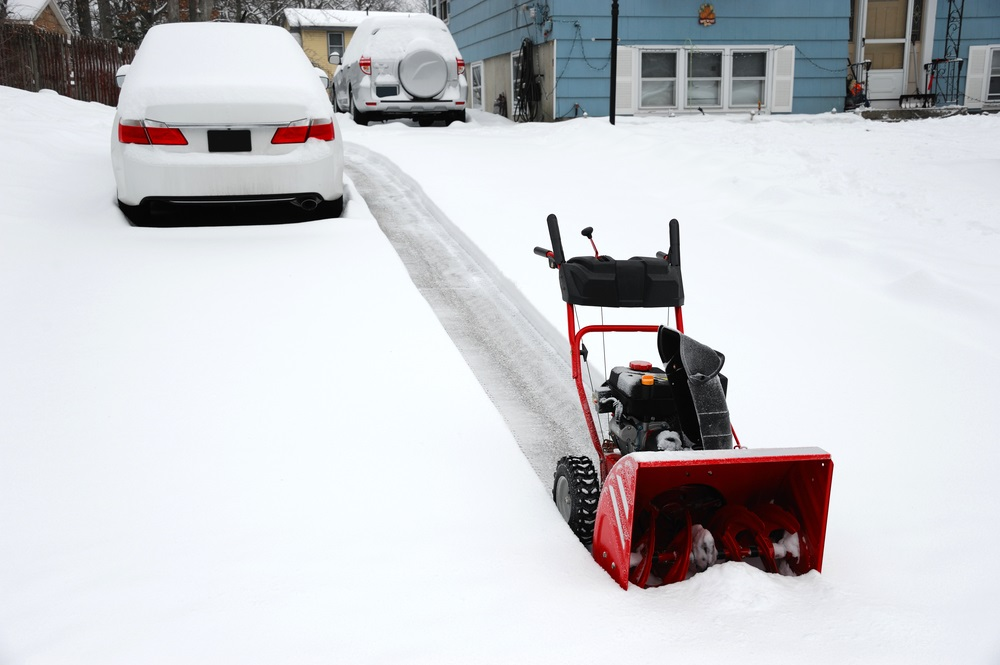 removing snow with snowblower