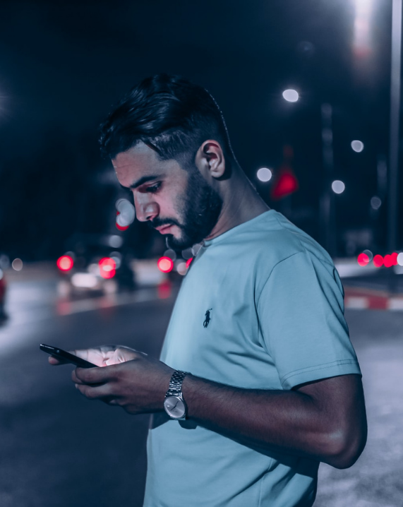 Man reading text messages on phone
