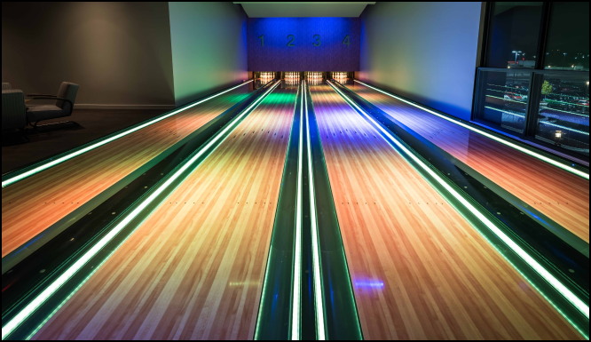 Bowling alley lit with multi-color lights