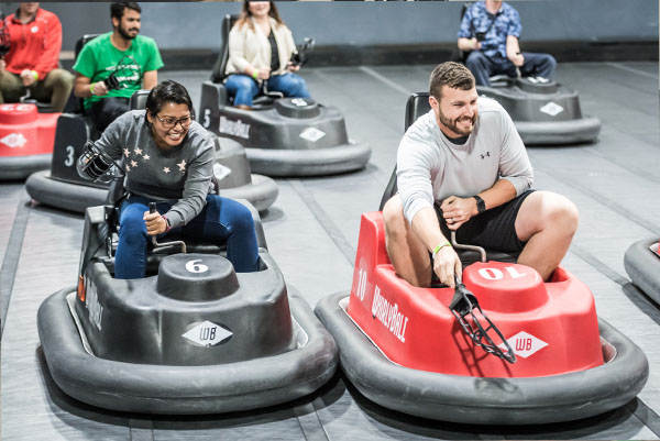 People on bumper cars playing WhirlyBall