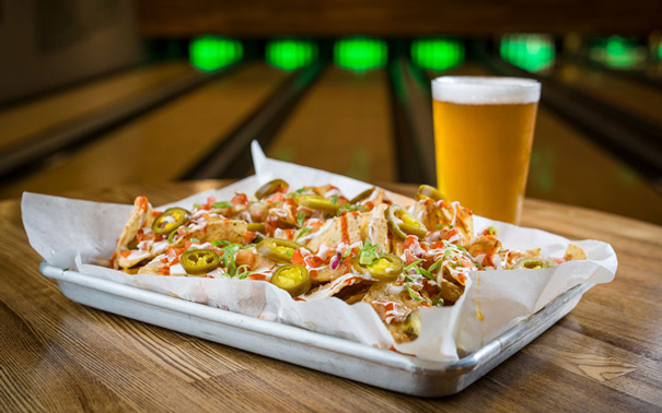 Nachos and beer in a bowling alley